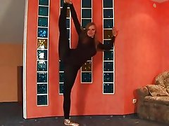 Flexible teen ballerina in black body stocking streching