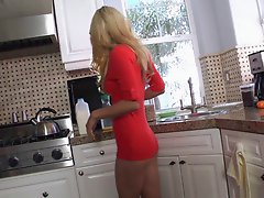Busty blonde honey uses her tea spoon as a sex toy in kitchen