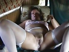 Older slut using several toys to masturbate