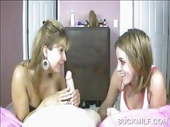 Lusty cougar giving blowjob on knees