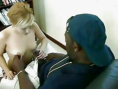 Short haired Amber Wild fills her filthy mouth with a massive black errect cock