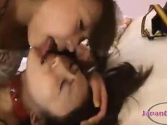 Asian Girl With Collar Spitted To Mouth Kissing With Her Girlfriend On The Bed In The Roo