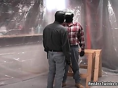 Weird masked guy bands over and gets ass spanked and