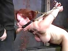 Redhead slave bitch deepthroats her master while tied up BDSM