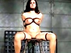 Busty BDSM loving bitch gets caned by her dungeon master