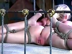 Bound bitch in bed receives punishment from master BDSM porn