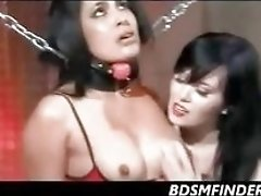 Sexy dominatrix bounds, spanks and fingers her submissive Latina babe