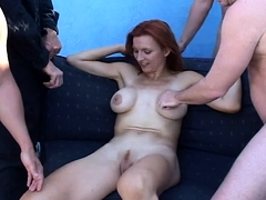 Big breasted cougar in lingerie takes on a gang of cocks