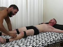Bound in bed stud tickled by his lover using a toothbrush