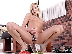 Naughty blonde dumps hot yellow piss into her mouth