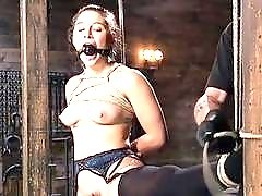 Babe in bondage gets tits tormented by master BDSM porn