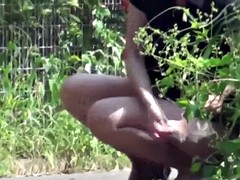 Naughty Asian sluts get caught while peeing in a park
