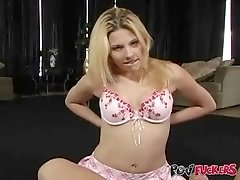 Innocent-looking blonde Genesis Skye takes off her bra and gives a great handjob