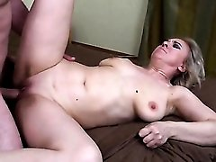 Big cock fucks slowly into her shaved mature pussy