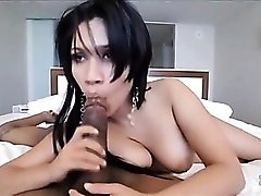 Cocksucker with big naturals sits on her man