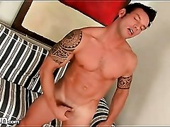 Gorgeous muscular guy jerks off and cums