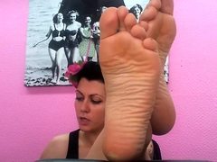 Seductive German babe exposes her sexy feet for the camera
