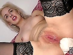 Blonde amateur wears a butt plug and shows off her cunt