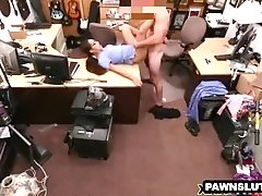 Brunette in glasses taking a facial at the pawn shop