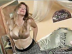 Masturbating mature tease in black pantyhose