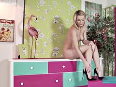 Naked blonde teases for erotic pleasure in stiletto heels