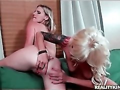 Blonde slut Meagan Maze finger fucks milf