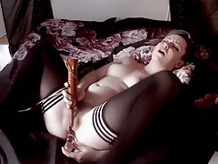 scene girl uses dildo and vibrator on bed