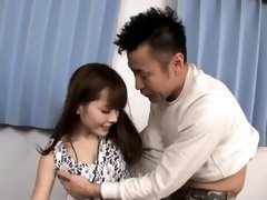 Oriental strokes her own boobs before giving sexy oral