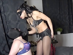They are feminized by their strap-on dommes in same room