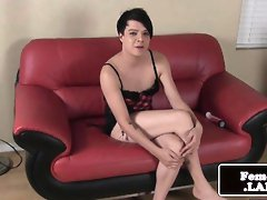 Masturbating femboy rides vibrator on couch