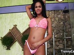 Pink bikini shemale enjoying solo