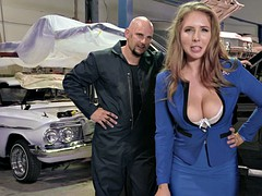 lena paul shows off her big natural tits in the mechanic shop