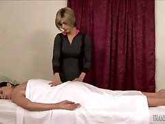 Tranny gives a massage and fucks her client