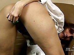 Green dildo fills up her shaved milf cunt