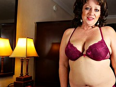 chubby mature woman presents her big jugs