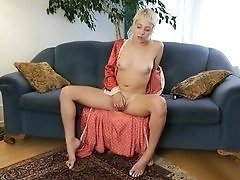 Amateur blonde with a nice bush masturbates solo