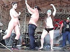 Roadies pour water on topless dancing girls