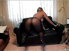 Solo milf in sheer black pantyhose masturbates